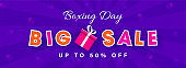 Big Sale header or banner design with gift box and 50% discount offer on purple rays background for Boxing Day.