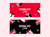 Boxing Day Sale banner design decorated with gift boxes and stars in two color option.