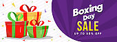 Boxing Day Sale header or banner design with 50% discount offer and gift boxes on white striped and purple rays background.