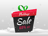 Advertising banner or poster design with 60% discount offer and gift box on snowy background for Holiday Sale.