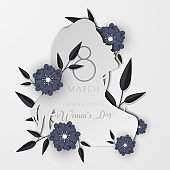 Paper cut style woman illustration decorated with grey flowers for International Women's Day greeting card design.