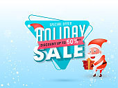 Holiday Sale banner or poster design with 50% discount offer and illustration of santa claus holding gift box on blue snow background.