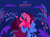Young Couple holding Pink Heart on Nature View Blue Background for Happy Valentine's Day, Love is in the air.