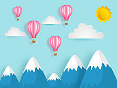Paper cut style landscape background with hot air balloon, clouds and sun.