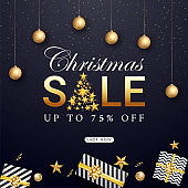 Christmas Sale poster or template design with 75% discount offer, top view of gift boxes, stars and baubles decorated on blue background.