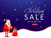 Christmas Sale banner or poster design with 50% discount offer, illustration of santa claus and gifts bag on blue snowflake lighting effect background.