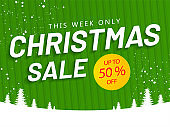 Christmas Sale banner or poster design with 50% discount offer and xmas tree on green striped pattern and snowy background.