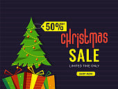 Christmas Sale banner or poster design with 50% discount offer, gift boxes and Xmas tree on purple striped background.