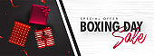 Sale header or banner design with top view of gift boxes on black and white texture background for Boxing Day.