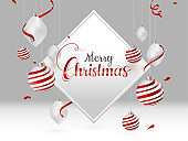 Calligraphy text Merry Christmas in white frame with hanging baubles decorated on grey background can be used as greeting card design.