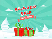 Sticker style Boxing Day Sale text with gift boxes and paper cut style xmas tree on snowy and green rays background.
