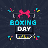 Flat style poster design with Boxing Day Sale text on creative gift box decorated with geometric elements on blue rays background.
