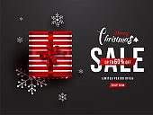 Top view of gift box with snowflakes and 60% discount offer for Merry Christmas Sale banner or poster design.