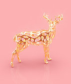 Golden Christmas reindeer figure on pink background