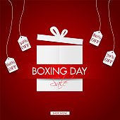 Boxing Day Sale poster design with hanging tag of different discount offer on red background for Advertising concept.