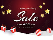 Sale banner or poster design with 60% discount offer, baubles and gift boxes on snowy brown background for Happy Holiday.