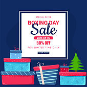 Boxing Day Sale poster design with 50% discount offer, xmas tree and gift boxes on blue background for Advertising concept.
