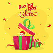 Boxing Day Sale poster design with surprise santa claus in gift box on yellow background.
