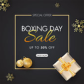 Boxing Day Sale poster design with 50% discount offer, top view of gift box, baubles and snowflakes decorated on black background.