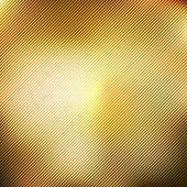 Abstract gold blurred gradient style background with diagonal lines textured.