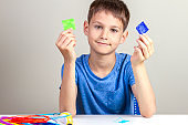 Child creating with 3d pen new object