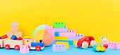 Baby kid toys collection on blue and yellow background