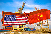 Concept of trade confrontation between China and USA. Clash of Chinese and American containers. Rendering 3d
