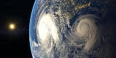 Hurricane visible above the earth, satellite view.