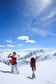 Amateur Winter Sports alpine skiing. Woman snow skier enjoy at sunny ski resort. High mountain snowy landscape. Livignio, Alps mountain Europe, Italy.