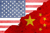Closeup crack of USA flag and China flag .It is symbol of tariff trade war crisis between United States of America and China which the biggest economic country in the world.