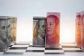 USA dollar and China Yuan banknote  on chess table. Its is symbol for tariff trade war crisis or unfair business of 2 biggest economic countries in the world.