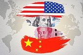 US dollar and Yuan banknote on USA and China flags. Its is symbol of economic tariff trade war crisis between United States of America and China which the biggest economic country in the world.