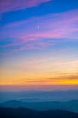 The picturesque mountain landscape on the sunrise background