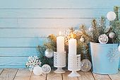 white Christmas decorations on blue wooden background