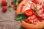 cake with strawberry on wooden background