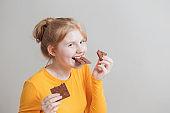 funny girl eating chocolate