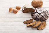 different types of bread on wooden background