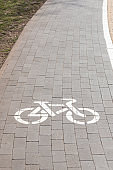 White bike path sign