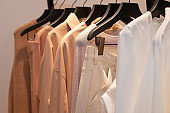 Fashion Design Clothes on Display rack in retail