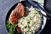 grilled chicken leg quarter served with Cauliflower rice or couscous