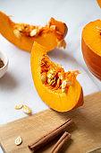 pumpkins with cinnamon sticks on marble backgrund