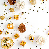Christmas composition. Flat Lay with Christmas golden deco baubles on white. Copy Space. Horizontal.