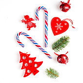 Red christmas decoration on white background. Flat lay