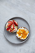Fruit sandwiches with vegan ricotta cheese on marble background. view from above with copy space