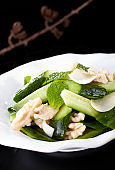 Delicious Chinese cuisine, salad with walnuts and cucumber