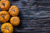 Pumpkins on old rusrik wooden.