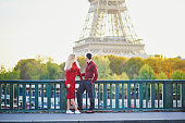 Romantic couple in love near the Eiffel tower