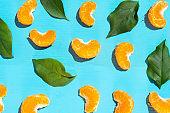 Segments of tangerine on blue background