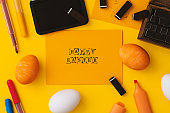 Yellow happy easter flat lay on yellow background