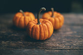 Small pumpkins on wood tabletop